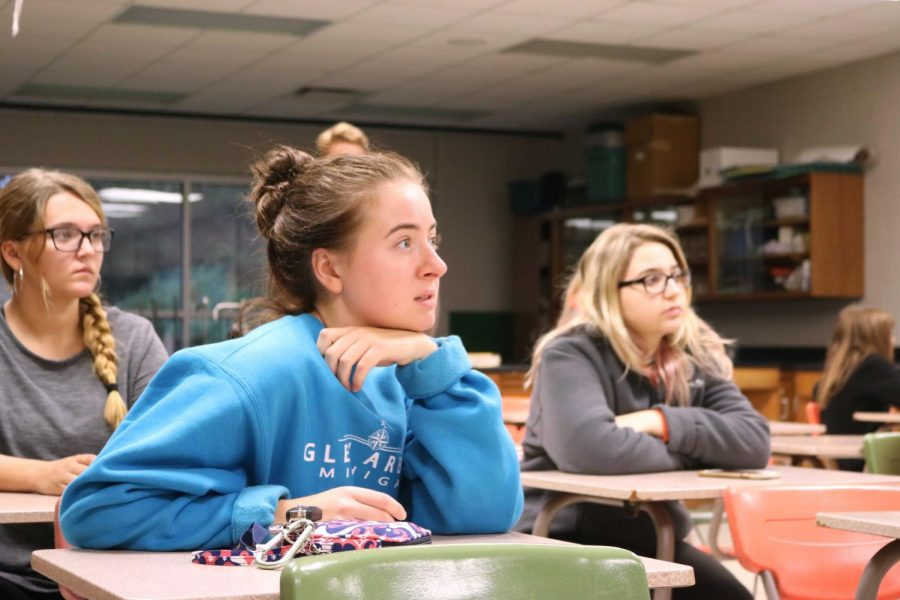 After the first scenario, senior Evelyn Eck pays close attention to first hour teacher Lisa. Stewart (not depicted) during the ALICE training class discussion. The whole school participated in ALICE training on Oct. 5.