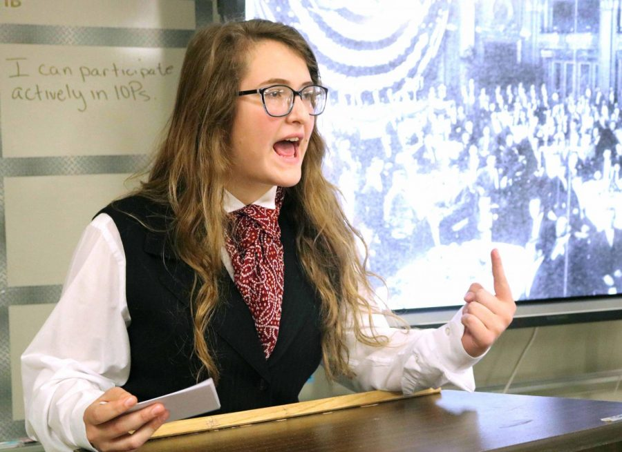 In Americans Studies (AMS), students in Patricia Gray and Heather Mulligan's classes dressed up as historical figures. Sophomore Lilah Dagenis was presenting her speech in front of her classmates on Oct. 29.