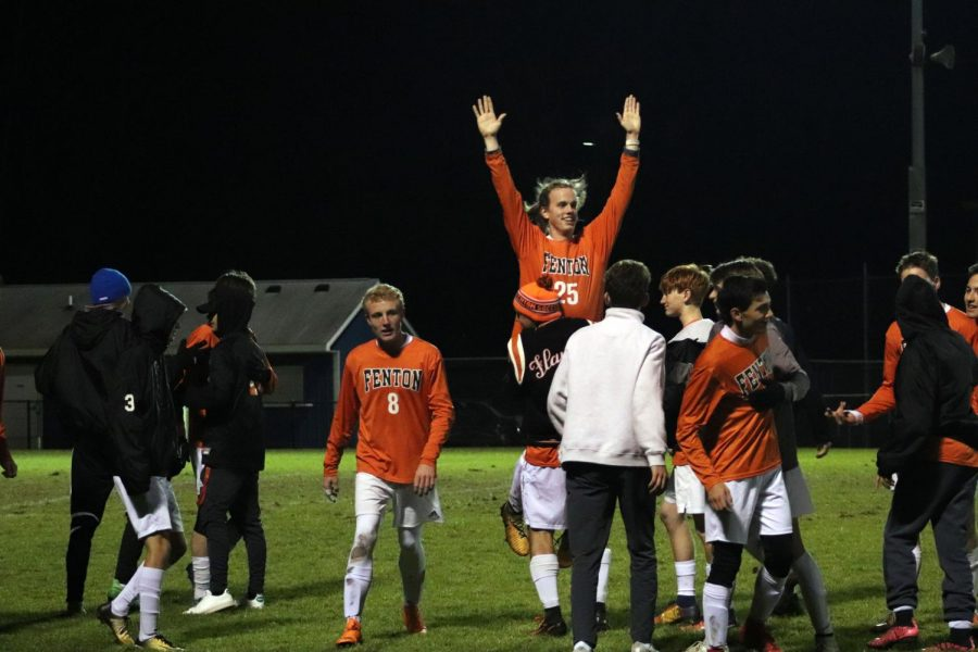 As they celebrated that they made it to districts, Junior Ben Sheffield picks up senior Jackson Rasette after there game on Oct. 23. Their season came to an end with the score of 0-3 against Cranbrook.