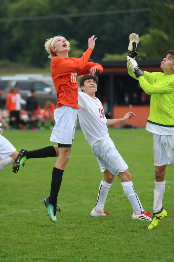 Leaping in the air, freshman Justin Miller attempts to head the ball to score a goal. The boys JV soccer team beat Holly 7-0.