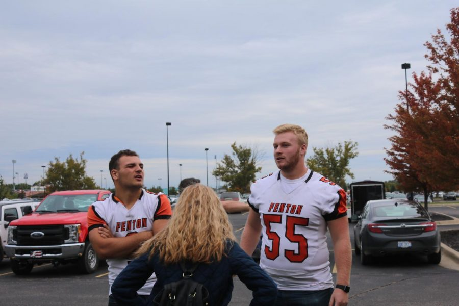 While hiding from the intruder outside, seniors Dane Dean and Spencer Rivera wait to go back into the school. They discussed the situation with the custodian.