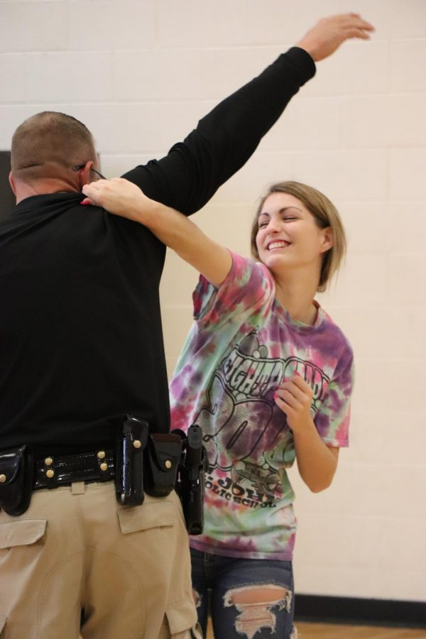 Officer Cole sets out to make life a little safer by teaching the girls self-defense, like junior Emma Harper. Officer Cole taught them many ways to defend themselves in different dangerous situations.