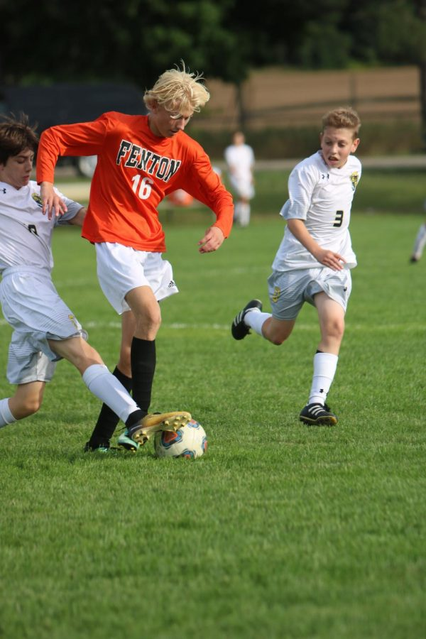 Focusing on the ball, freshman Justin Miller tries his best to recover the ball from the Oxford players. The Tigers won the game 1-0.
