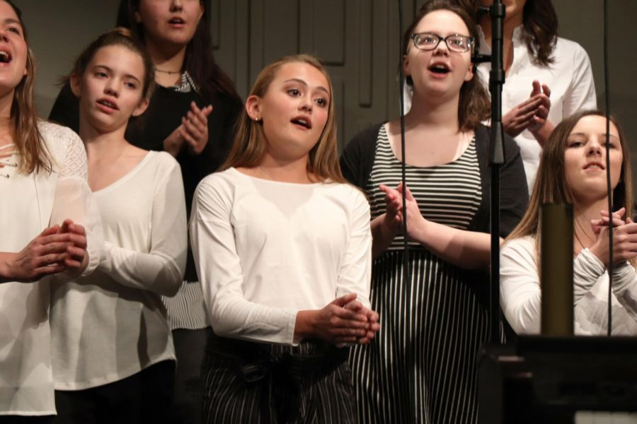 Happiness! Bella Voce sings about happiness at the Fall Informance. Sophomore Victoria Carnell claps to and sings Happiness by NEEDTOBREATHE along with the rest of the Bella Voce.
