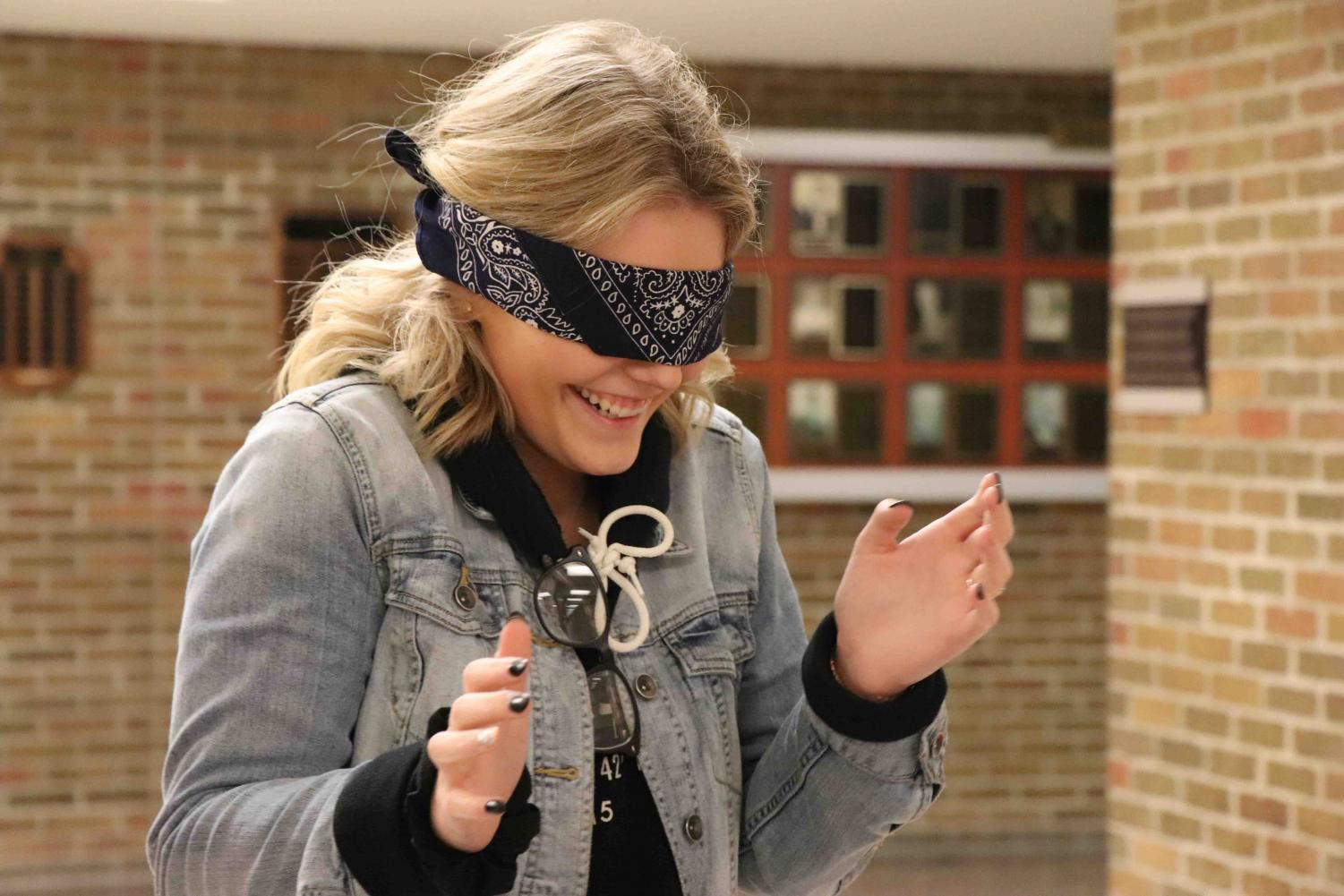 Scared of the unknown, senior Grace Hocevar struggles to adapt without her sense of sight. Jill Starr's psychology classes participated in a lab that shows when the sense of sight is removed, other senses are enhanced.