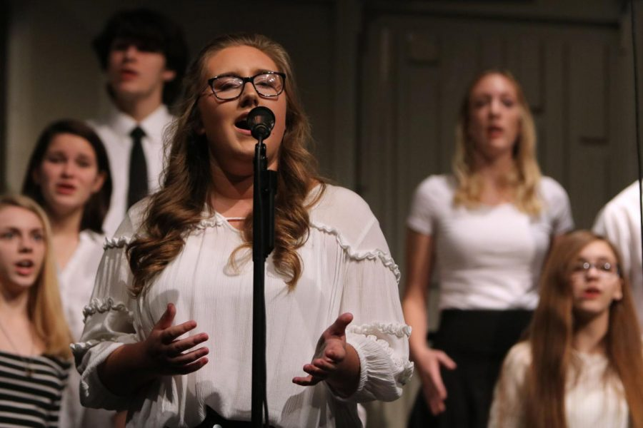 Invested in the music, sophomore Drew Baldwin sings a solo for the song Run, Mary, Run. On Oct. 25, the choirs held their annual Fall Informance concert to kick off the year.