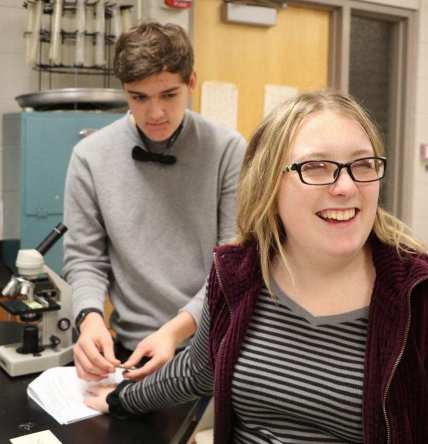 Waiting for the poke of a needle, senior Jenna Thorton looks away from her lab partner, junior Joe Henley, during the touch receptor lab. Lisa Stewart's anatomy classed tested the nerves on different parts of their bodies to see which part had the most neurons.