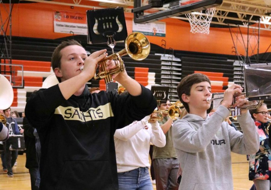 To the beat of a drum, senior Noah Serridge and sophomore Braden McDowell play along to