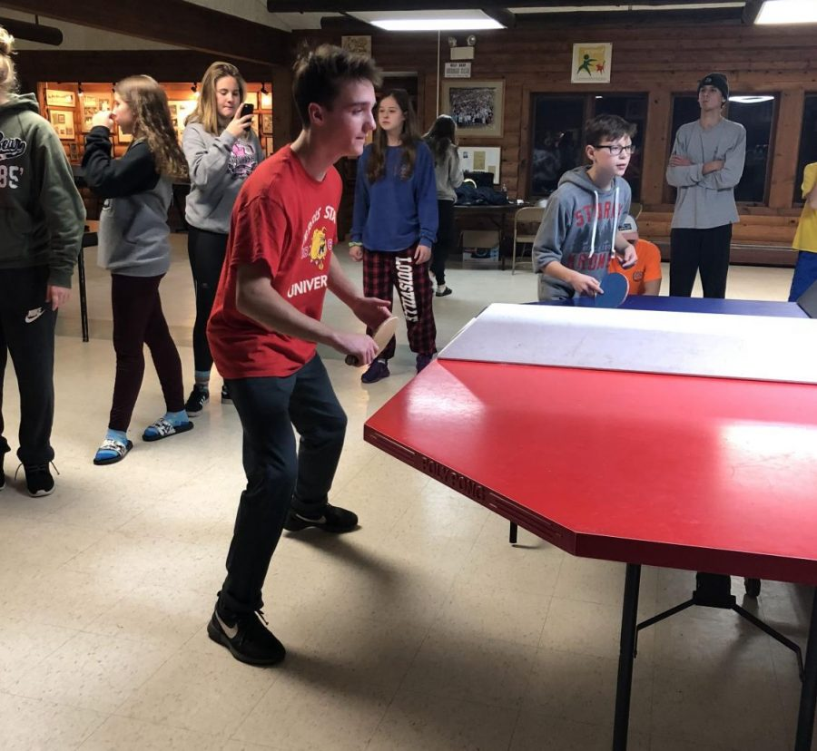 Waiting for the ball, senior Braden Lapa plays a game of Poly-Pong with his teammates. The Fenton, Linden, Lake Fenton ski team traveled to camp Hayo-Went-Ha for  a team bonding weekend from Oct. 8 to Oct.11.