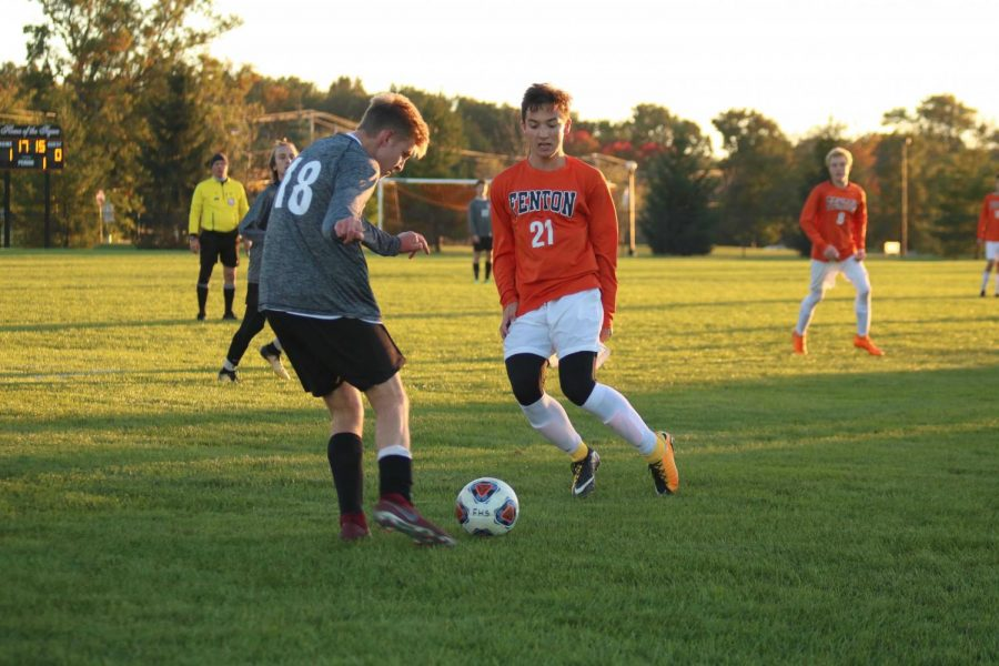 The varsity boys soccer team played Linden and went into overtime on Oct. 18. Pictured here, junio Alex Flannery blocks his Linden opponent. In the end, the Fenton soccer players won 2-1 and moved onto the next round in the metros league contest.