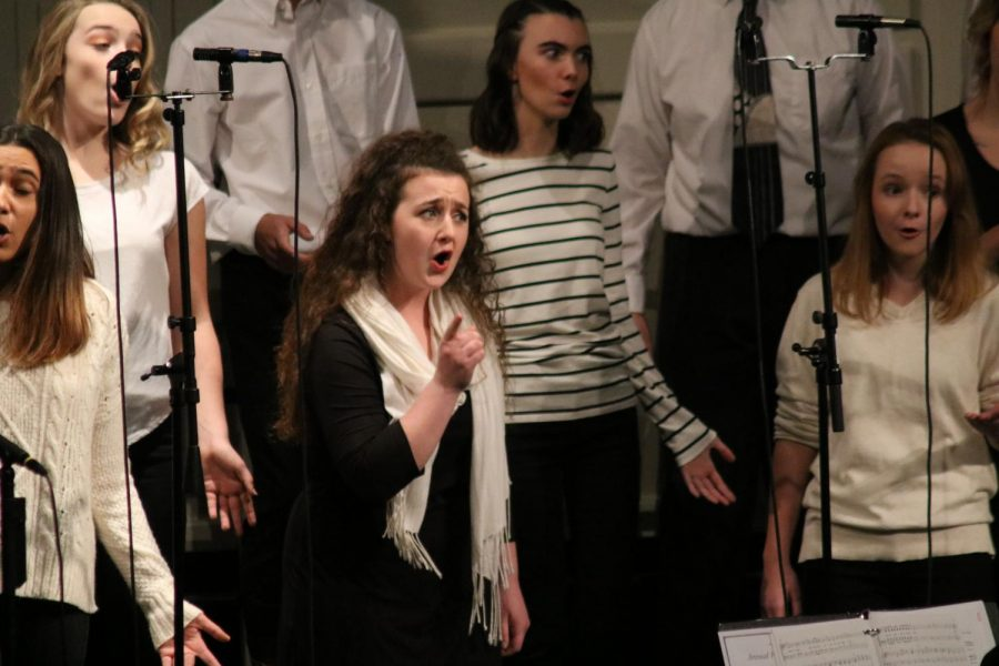 Member of Varsity Vocals choir, junior, Jenna Maher, performs during on of their songs. The choir Fall Informance kicked off the choir season on Oct. 25.