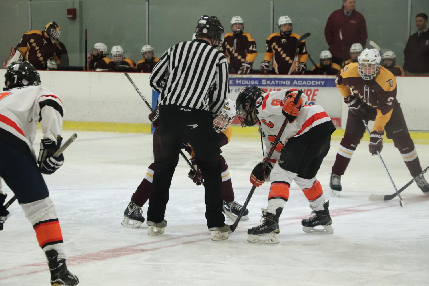 Senior Dylan Conte faces off against his opponent in the 2017-2018 hockey season. Tryouts for the 2018-2019 season were held on Oct. 29-31.