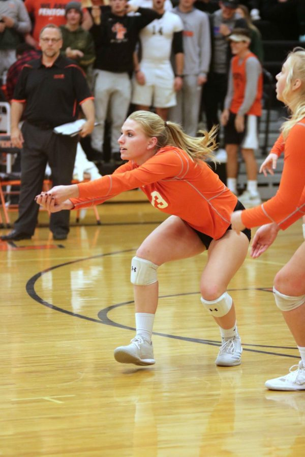 While listening to the student section cheer, senior Erin Carter bumps the volleyball to her teammates.  On Nov. 1, the girls varsity volleyball team played Grand Blanc in District Finals.