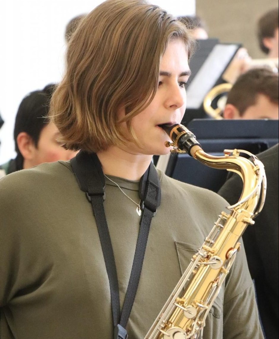 Senior Caitlyn Dailey plays her tenor saxophone. Members of the Jazz Band performed for students during lunch on Dec. 14.
