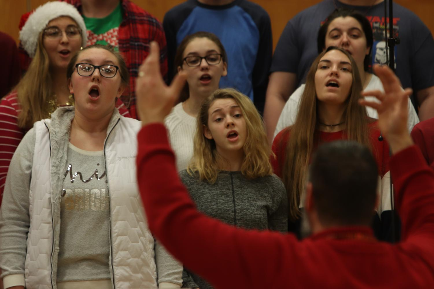 Choir teacher Brad Wright conducts the Bella Voche singers. During SRT on Dec. 20, Jazz band and all choirs performed for students.