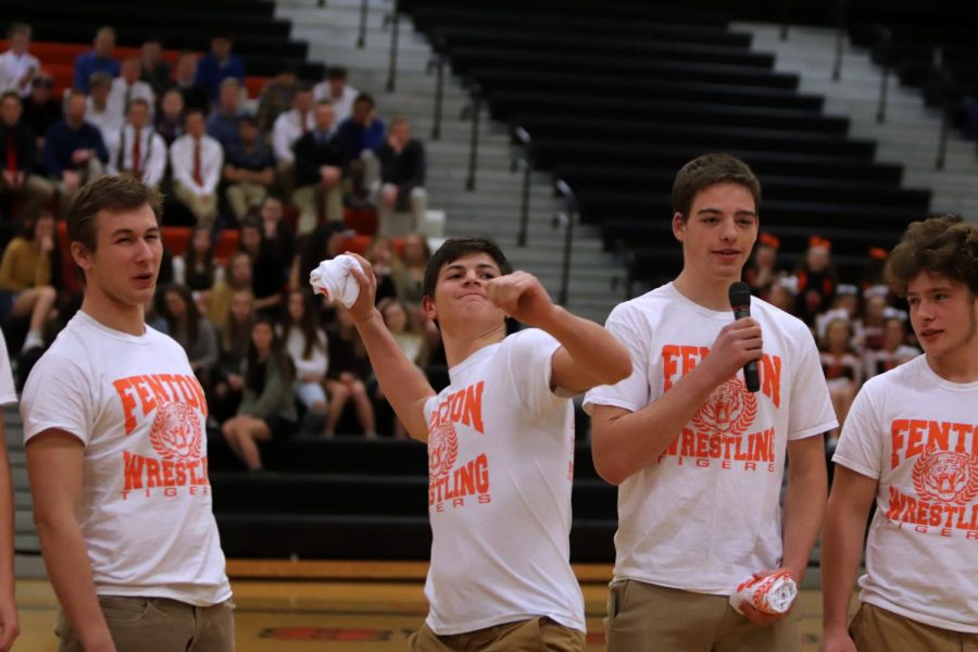 The Fenton wrestling team launches t-shirts into the crowd at Meet the Team. Meet the Team helps parents understand schedules and  learn the player's names.