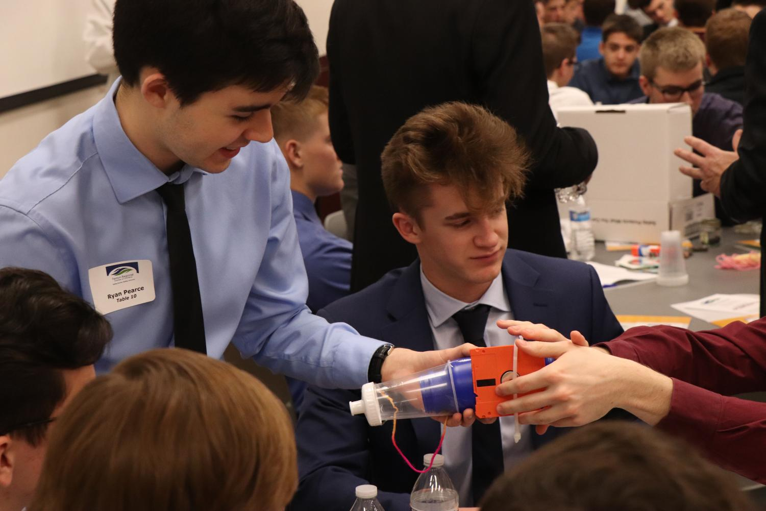 Senior Brady Young and junior Ryan Pearce work with their group. Students attended the annual Boys and Business conference on Dec. 4.