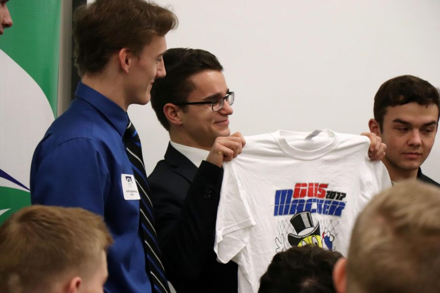 Tymek Barcinski and other Fenton students teamed up with Lake Fenton and Linden kids to create a product that's in demand and present it to a group of business owners. Boys in Business do this every year to help students have an idea of how a company works.