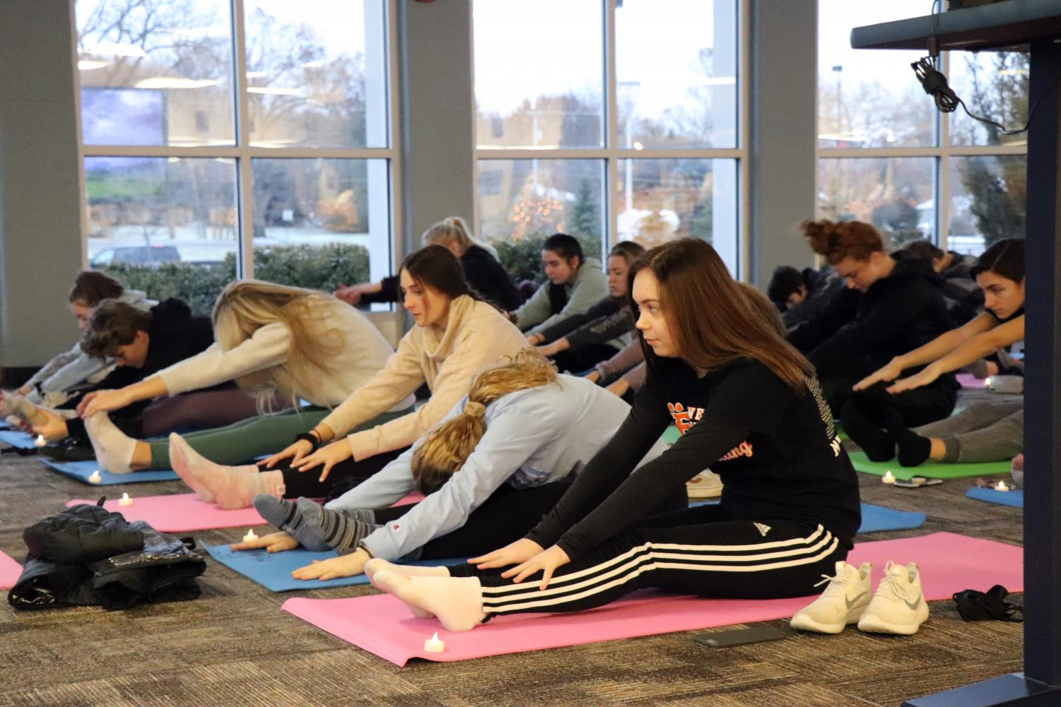 Yoga calms down the body and soul; junior Josie Rollier stretches her body to relieve stress. Every Monday and Wednesday, the Girls' Fitness class participates in yoga.