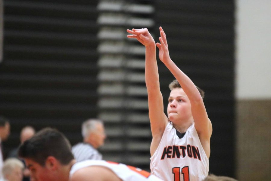 Aiming for the hoop, sophomore Cam Veres stands at the free  throw line. The Fenton boys JV basketball battled against Swartz Creek and won 60-45.