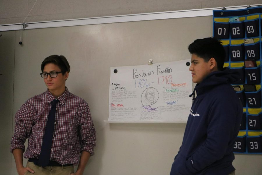 In Michelle Belsons second hour class, freshman Jacob Shanahan and Alexis Rivera Gomez present their poster. On Dec. 12 everyone presents the poster in class.