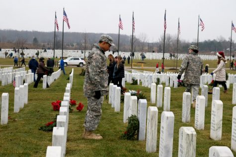 Cadet Black lays a wreath for the fallen soldier Thomas R. Gaulin. On 12-15, every year volunteers lay wreaths for the fallen soldiers of the army in Great Lakes National Cemetery.