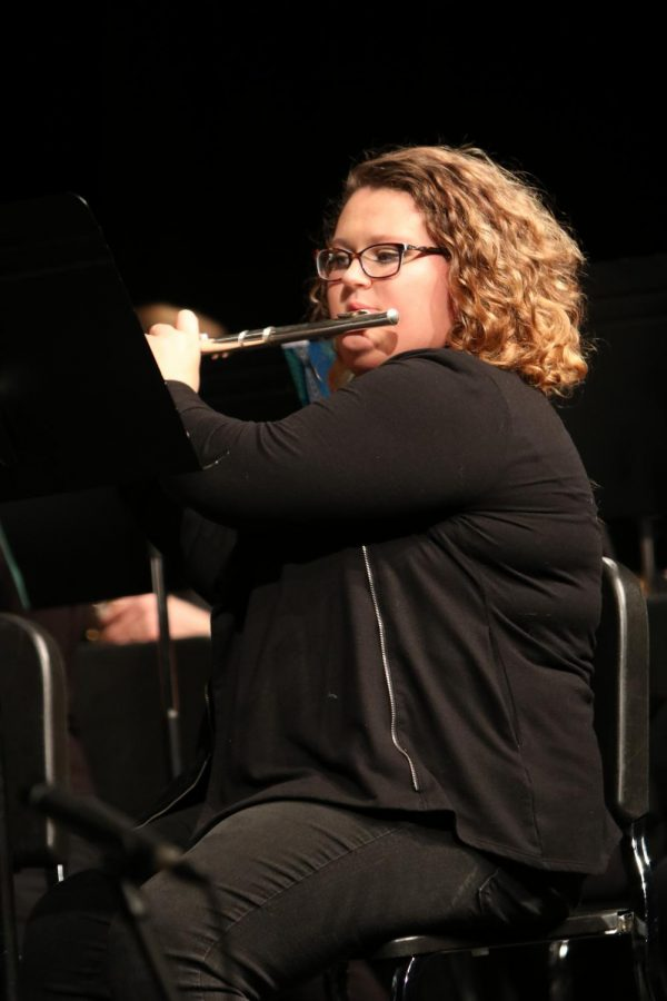 While playing her flute junior Lauren Megdanoff performs in front of the audience. On Dec. 13 there was a band concert for all of the bands except for Jazz band who had a concert on Dec. 9.