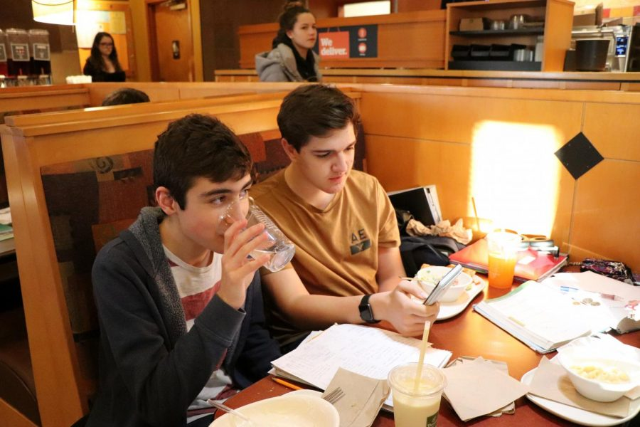Studying for their upcoming exams, sophomores Aaron Toth and Joe Henley enjoy their food while supporting the Fentonian. The Panera Fundraiser was held on Jan 14.