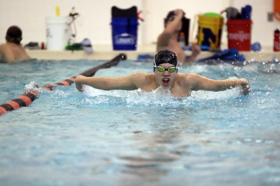 Practicing his butterfly form, junior Joel Diccion prepares for the away meet against Brandon. The next meet for the Boys' Swim team is Jan 15, against Owosso.