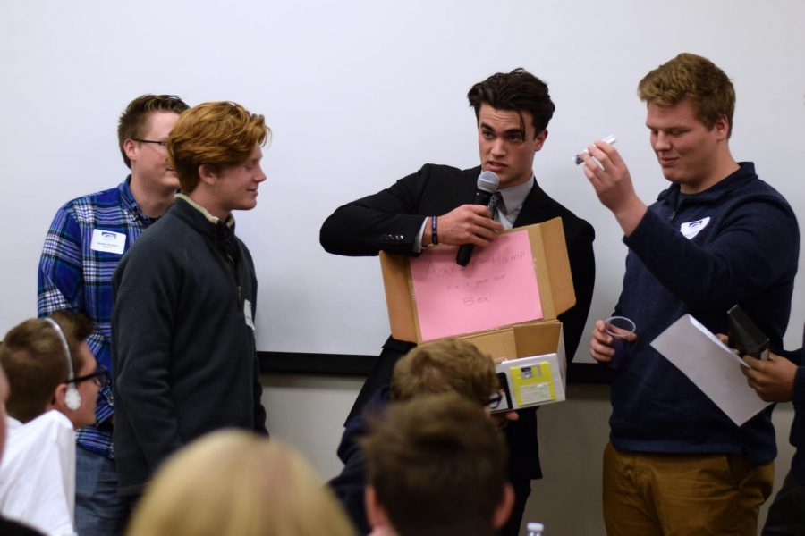 While attending Boys in Business, senior Jared Ryan presents his group's idea for a product proposal. Afterwards, the students listened to a select group of local business owners, who help lead groups of students to create their own products.