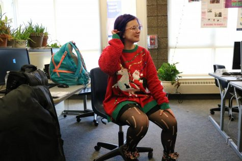 Showing off her Christmas spirit, sophomore Trinity Yost, wears her ugly sweater. Ugly Sweater Day was on Dec. 18.
