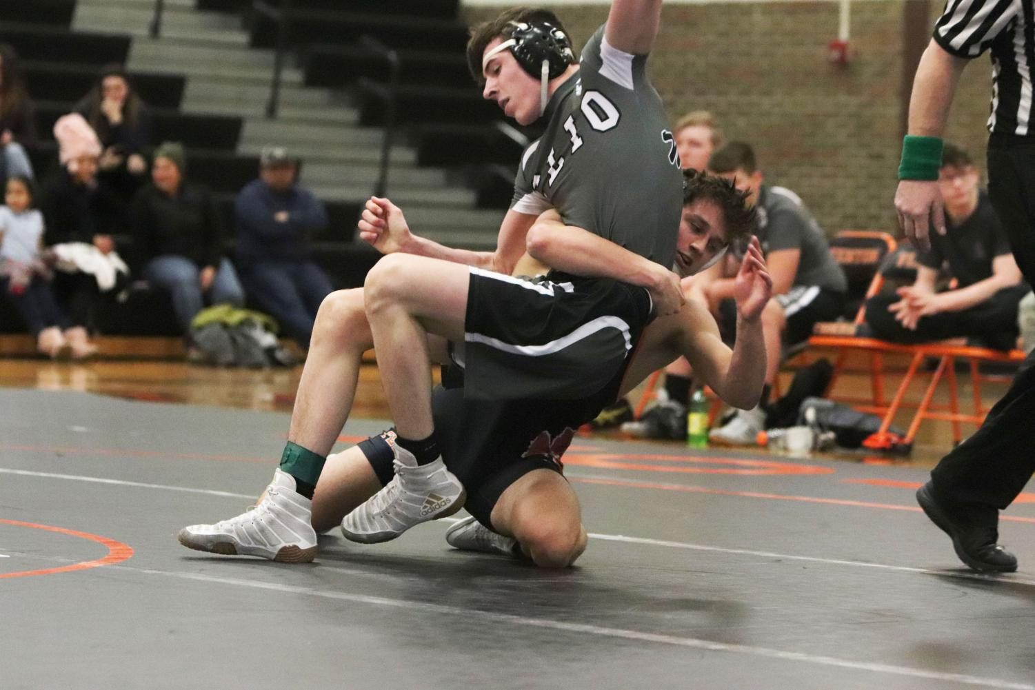 Junior Jayden Rittenbury takes down a Cilo student for his team on January 9. On Wednesday's meet Rittenbury placed 51 to 44.