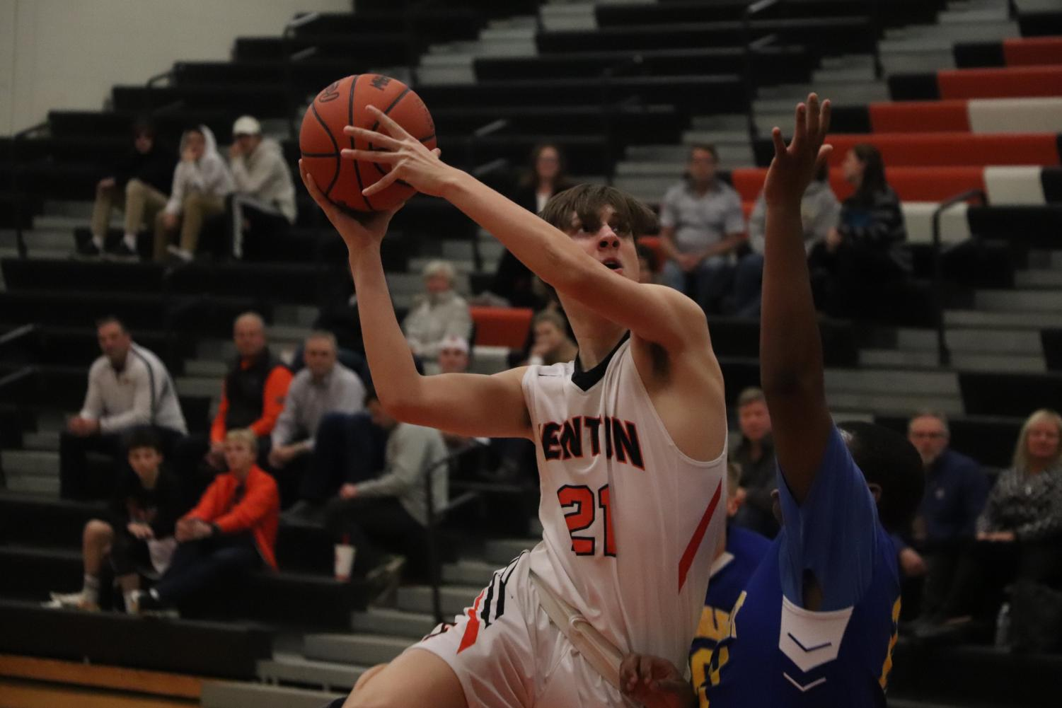 With the game coming to its final minute, sophomore Jacob Korzenowski jumps up in front of his opponent to draw a foul and still get his shot off and in. The Fenton JV boys basketball team ended up winning against Kearsley 54-45.