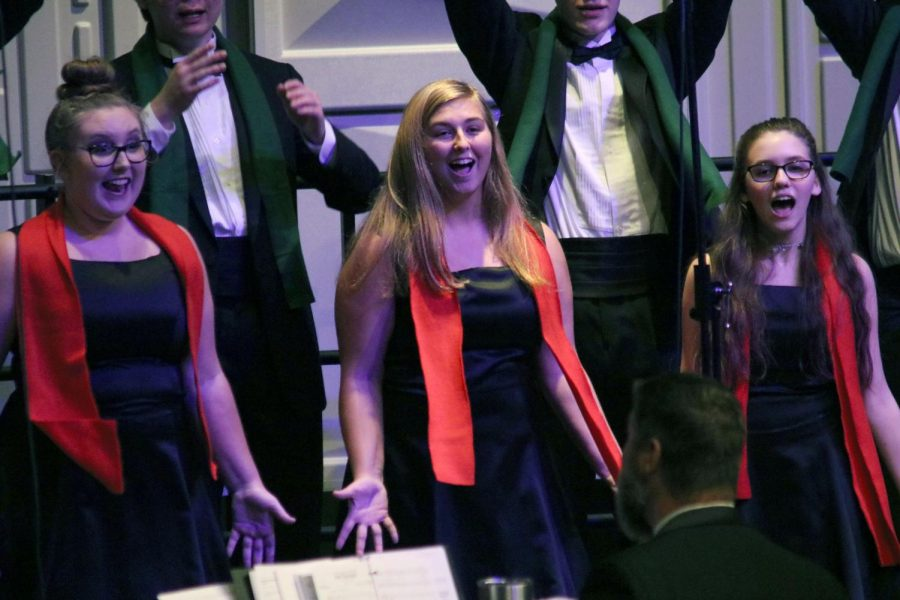 For the Christmas choir concert, senior Kara Piwowarczyk smiles and dances as she performs for the crowd. The concert was on Dec. 18 and included Varsity Vocals, Bella Voce, and the Ambassadors.