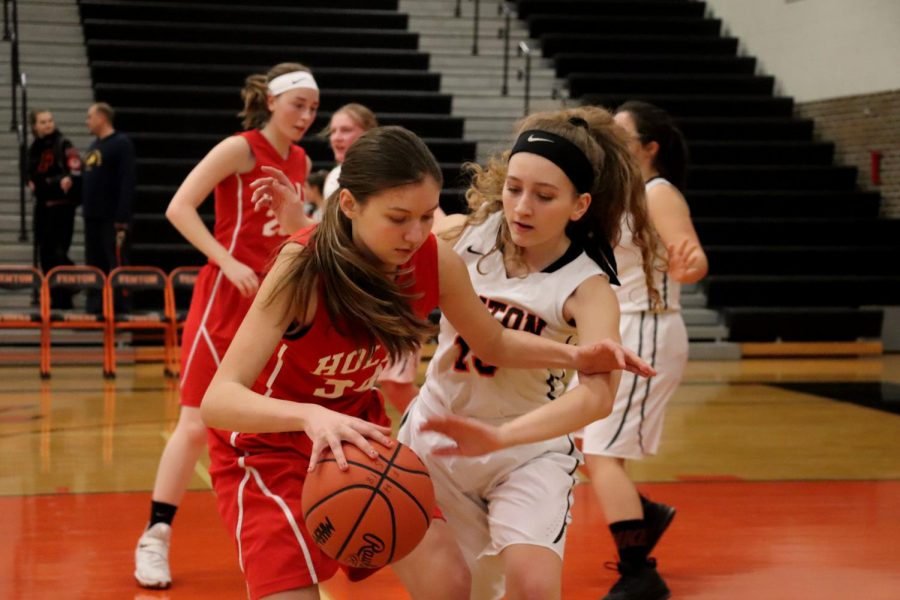 Sophomore Payton Van Pelt blocks her opponent from shooting the ball. On Jan. 4, Fenton played against Holly and won the game.