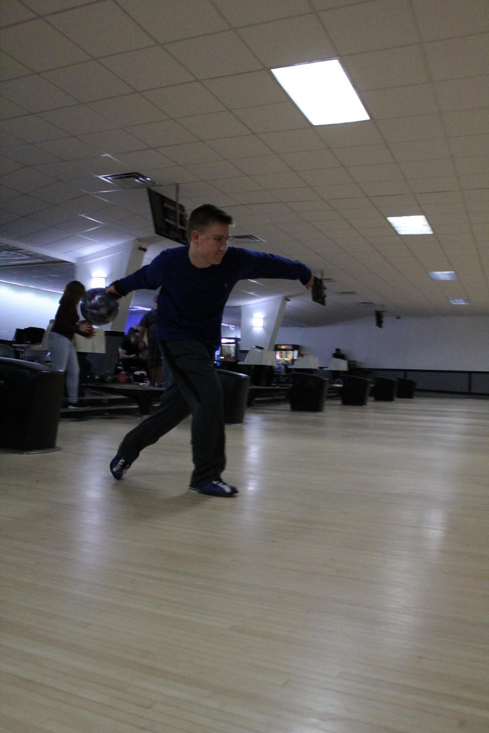 Sophomore Tate Temrowski tosses the ball down the lane.  The bowling team practices on Tuesdays and Fridays.