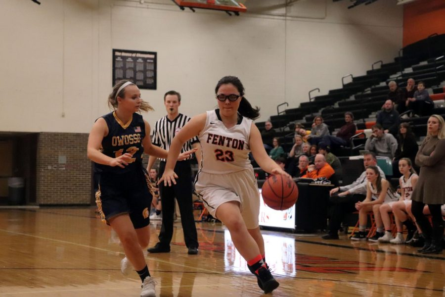 Fenton takes the ball from Owosso as sophomore Madelynn Thomas dribbles down the court. On Jan. 8, Fenton won against Owosso.
