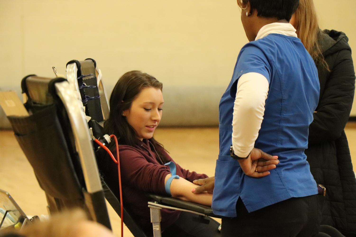 Waiting for instruction from the professionals, junior Ryleigh Malinowski gets ready to give blood. Every year Fenton High participates in multiple blood drives throughout the year to make an effort to save lives.