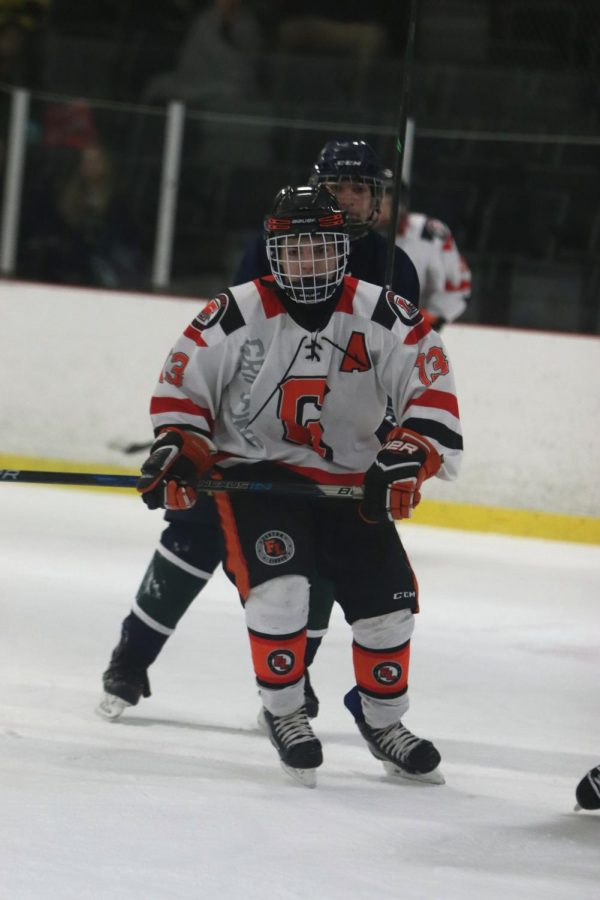 Defending the goal, Junior Hayden Justus skates for the puck on Saturday, Jan. 5. The Fenton/Linden Griffins defeated Waterford WLC United 8-0, making their record 9-3 for the season so far.