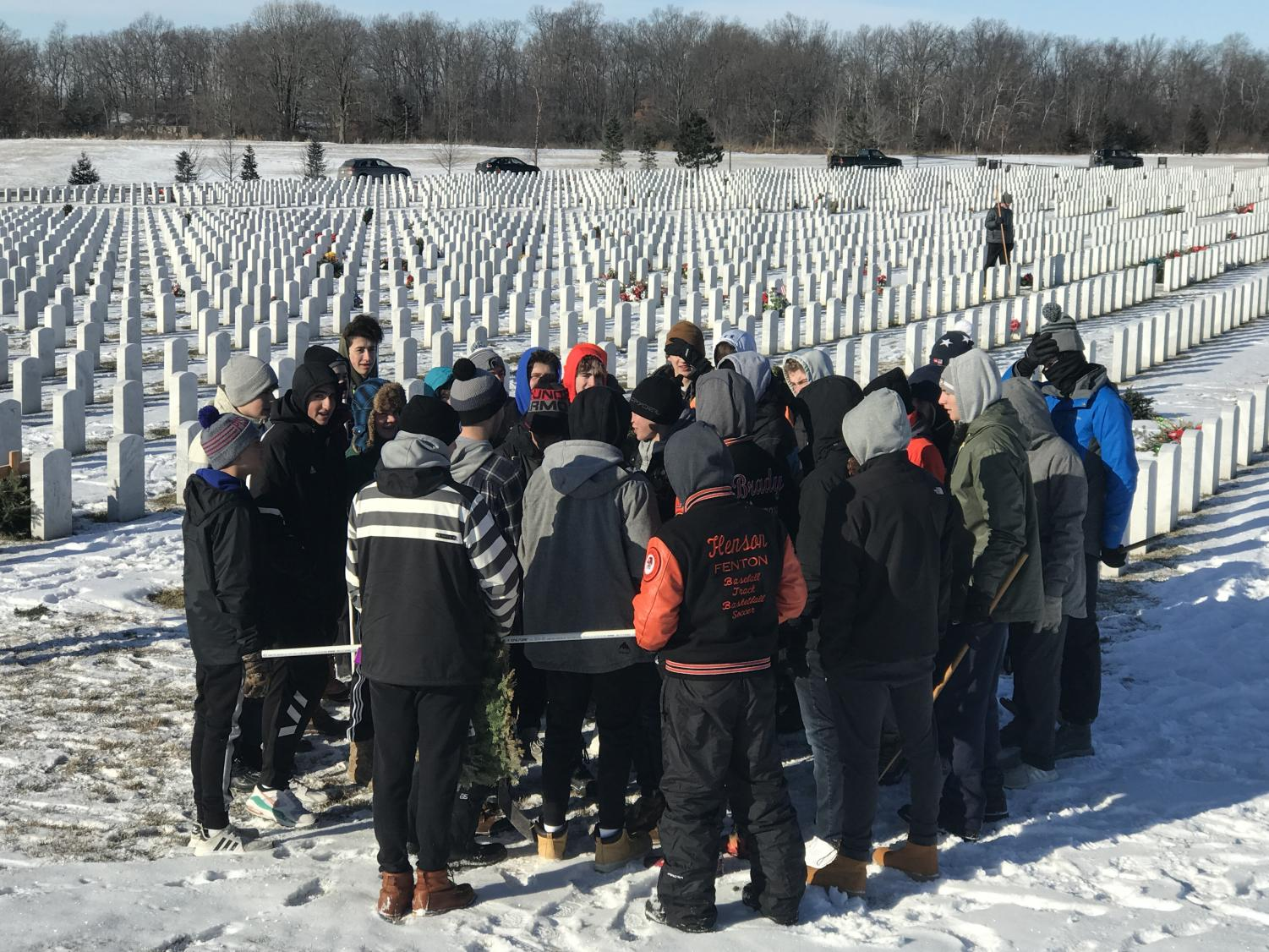Students gather at the National Cemetery on Jan. 26. Junior and Senior boys took down the wreaths that were laid on the graves earlier in the season.