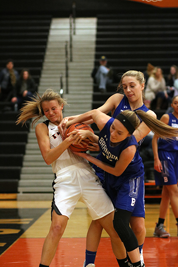 After running down the court, senior Hannah Chapin fights for the ball. The girls varsity basketball team beat the Brandon Blackhawks.