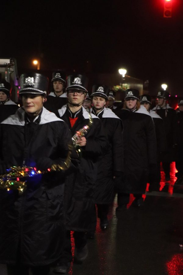 The Fenton marching band goes through downtown to celebrate the upcoming holiday and Jinglefest. Even though it rained, the school spirit carried throughout the city.