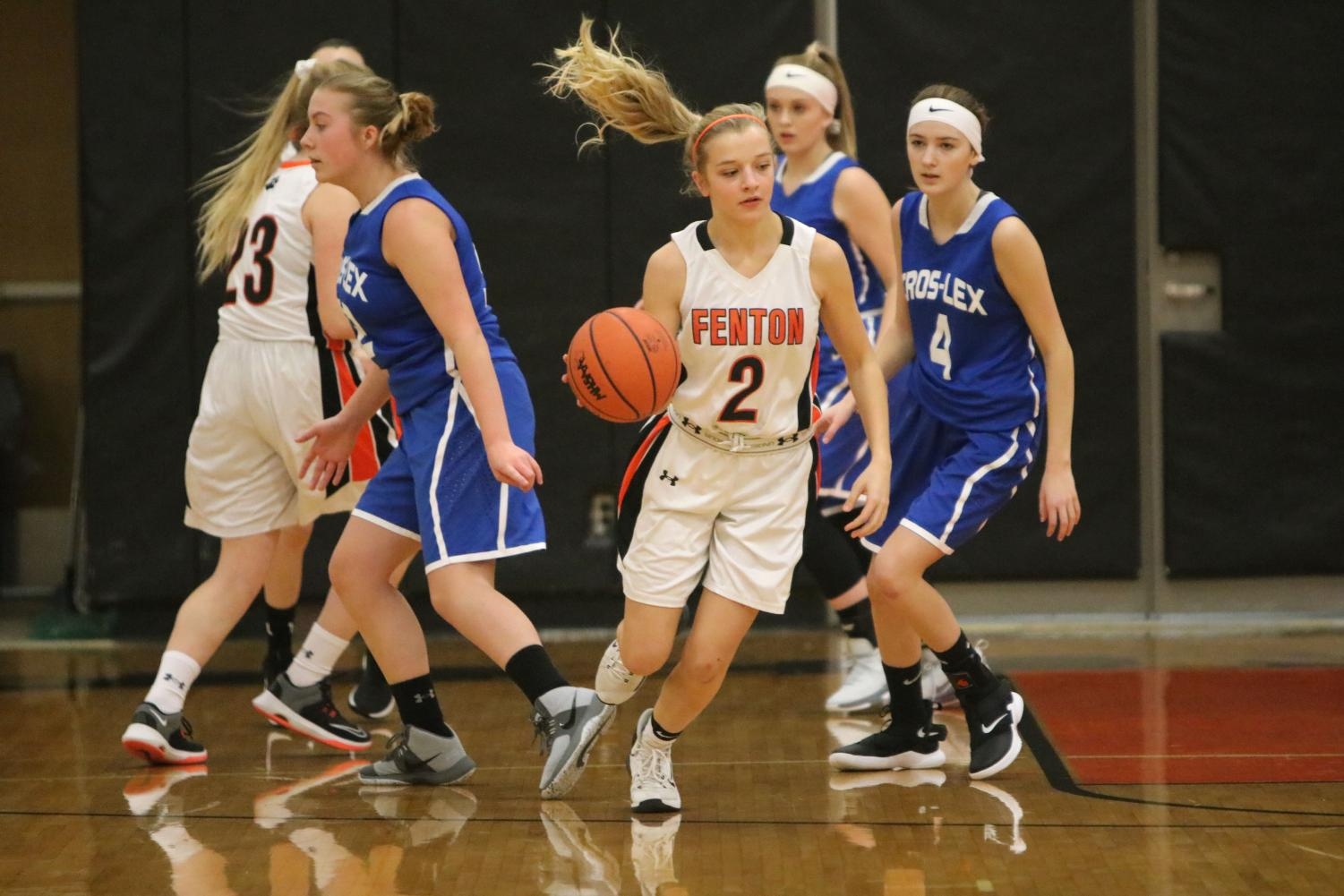 The basketball is dribbled down the court by freshman Jordyn Bommersbach during a game. On Jan. 8, the freshman girls basketball team played Lexington-Crosswell, winning 50-23.