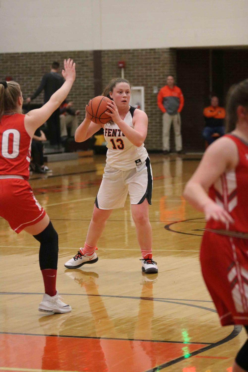 On her feet, sophomore Kyla Lynch gets ready to pass the ball. The girls varsity basketball team played before the boys varsity basketball team on Friday, Jan. 4.