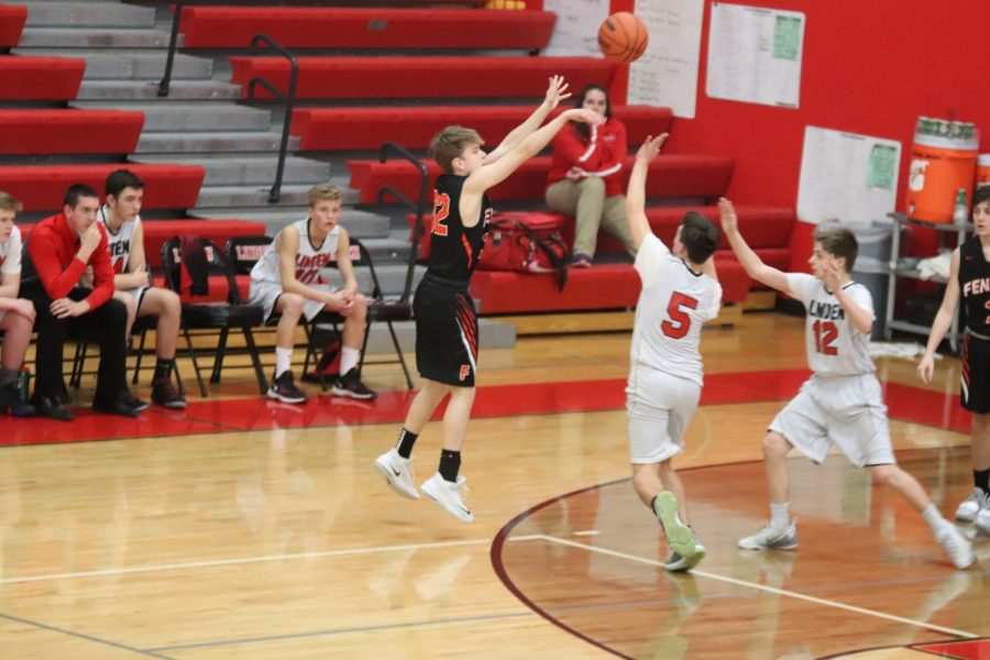 Freshman Austin Pedlar throws the ball at the three point line, the ball bounces around rim and then bounces out. In the end the freshman basketball team won with a score of 43-39 against Linden.