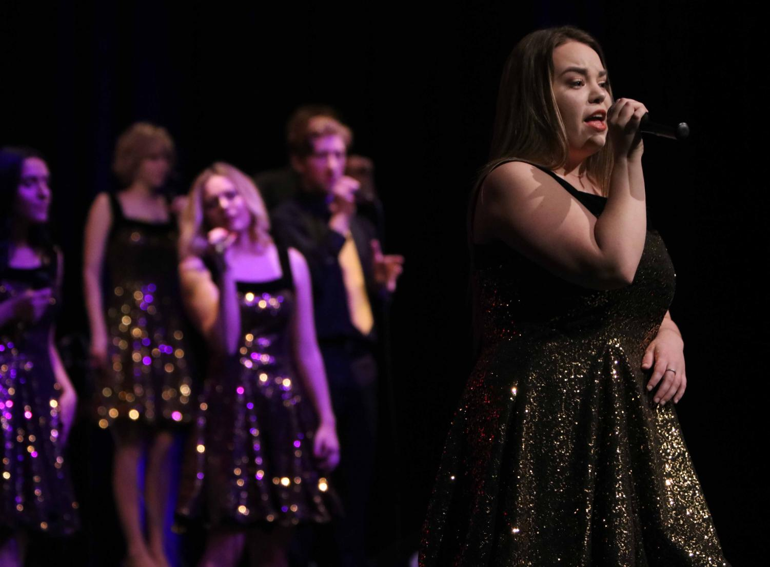 After going through hell week, senior Emily Hayes performs her solo at the Ambassadors concert on Feb. 23. Hayes started with the Ambassadors her freshman year of high school.