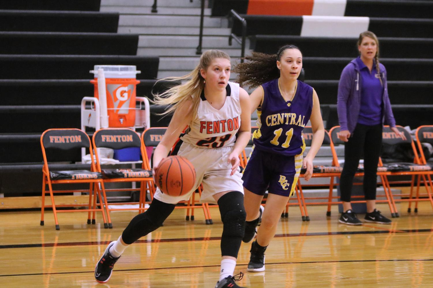 Freshman Alexandra Brown prepares to score a point for her team. On Feb. 19 the freshman girls basketball team played Bay City Central at home.