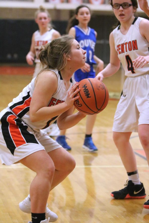 During a basketball game, freshman Olivia Resa aims to shoot a basket. On Feb. 21, the freshman girls basketball team played Saginaw-Nauvel at home.