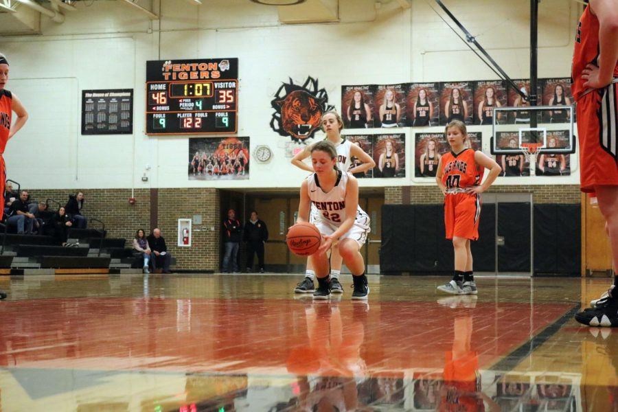 Amidst the fourth quarter sophomore Hannah Ludwig  prepares her shot. The game was tight, but Fenton defeated them by 13 points.