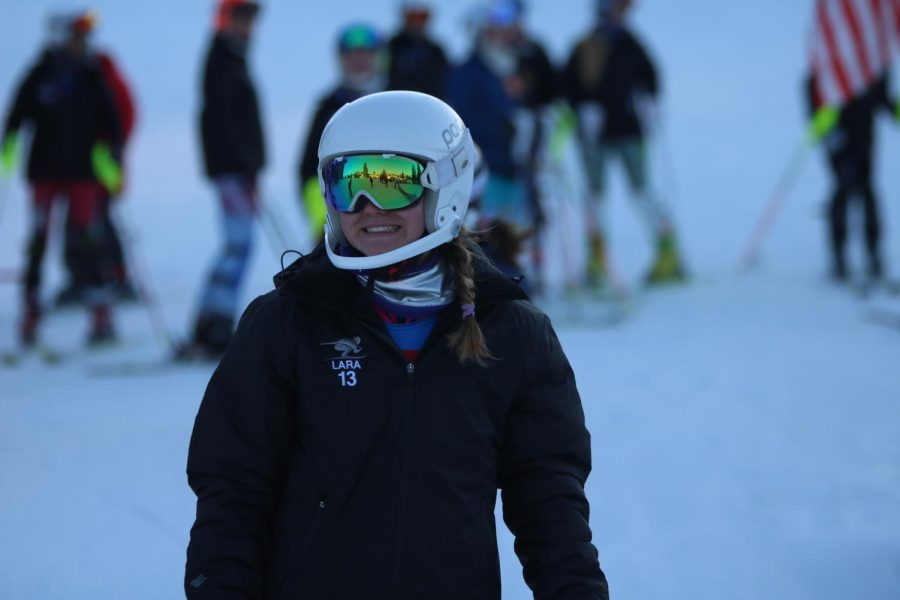 Sophomore Lara Kemp looks down the ski hill at her teammates. Skiers competed on Jan. 14.